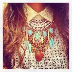 "Layered Necklaces That Make Your Neck Look Real Chic.  A good ""Bohemian"" look or change the style according to what you're wearing.  Definitely need to wear a choker first with gradual lengths following that.  You may not need the large pendant as the other stones are large enough.  Just experiment and have fun!"