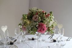 raised table centres using whites and pinks