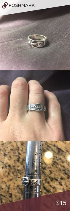 Sterling silver buckle ring Size 5 1/2. sterling silver stamp (925) on the inside. Buckle ring with designs on the side (does not go completely around the ring) in good condition. Jewelry Rings