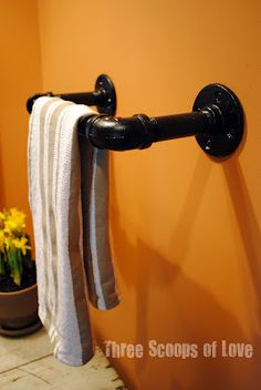 Pipe fitted towel and toilet paper holder. Couldn't we make a curtain rod from this also?