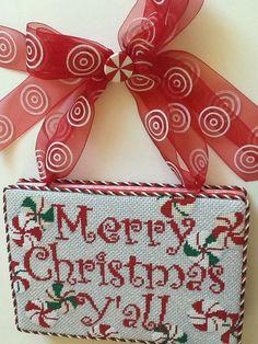 Boxed Christmas needlepoint hanging sign for Nimble Needle Atlanta, Raymond Crawford designer