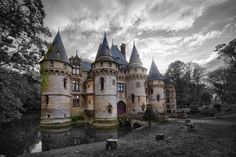Castle for sale:  Located only about fifty kilometres northwest of Paris, the original castle has a symmetry design starting with two towers flanking its main entrance, followed by two more towers at the corners. The entire castle, which is 37,000 square feet in size, is also surrounded by a moat, over which there are two bridges.