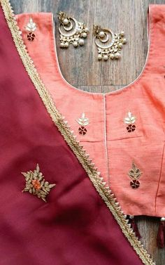 Burgundy Gota Patti Saree  Hand embroidered Gota Patti and Zardzozi motifs all-over the saree Lace border detail Peach Blouse piece (unstitched) in Dupion with Bootis done on Back/Front and sleeves.