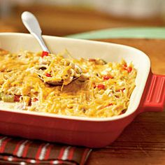 This chicken spaghetti casserole is low and calories and can easily be made ahead. The recipe makes two casseroles so enjoy one for dinner and freeze the other for later. To prepare the frozen casserole, cover and bake for 55 minutes at 350°; uncover and bake an additional 10 minutes or until hot and bubbly.