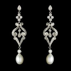 Stunning and vintage-inspired, these beautifully designed rhodium silver plated earrings are encrusted with sparkling Cubic Zirconias and topped off with a dangling diamond white pearl. A perfect acce