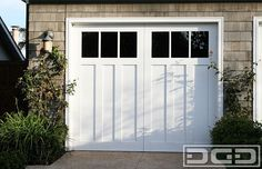 Learn how many people are injured by falling garage doors, broken garage door window glass, & pinching garage door panels and how to keep your family safe. Coastal Cottage, Door Design, Cottage, Carriage Style Garage Doors, Glass Garage Door, Carriage House Doors, Broken Garage Door, Garage, Garage Door Types