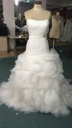 Organza bottom wedding dress with a strapless neckline. The bodice of this bridal gown is ruched. There is a small thin belt at the waist that is removable. We have many more large organza bottom wedding dresses at www.dariuscordell.com . Custom design are obtainable. Replicas of couture gowns for less are an option to explore.  Pricing starting from $500. #weddingdresses #bridalgowns