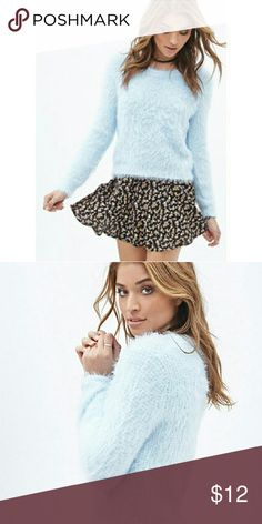 Forever 21 fuzzy blue sweater Shaggy fuzzy ice blue sweater from Forever 21 in a size large. Very soft. Forever 21 Sweaters Crew & Scoop Necks