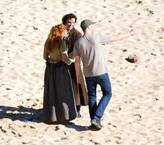 Aidan and Eleanor filming at Porthcuno beach.