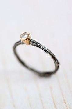 steel twig ring with stone. I would change the facet and stone)