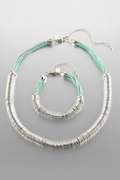 Bring spring in with these pastel and silver coloured Limited Collection ring bracelet & necklace set.
