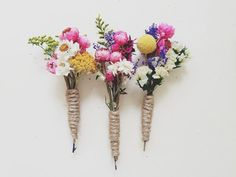These colorful boutonnieres include preserved greenery, ammobium, yarrow and billy buttons. They are wrapped with twine. ***The pins pictured are the ones you will receive    All boutonnieres have a 1 pin attached to the back for easy attachment that will stay on throughout the day. Every boutonniere is made with preserved floral, so they can last