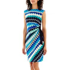 """<p>With is delightful print and deep colors, our knit side-tie dress will keep you front and center.</p><div style=""""page-break-after: always;""""><span style=""""display: none;"""">"""