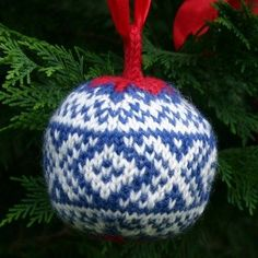 """A free knitting pattern for a Christmas Ball, my """"Marius"""" ball design, named after the iconic, traditional Norwegian """"Marius"""" ski sweater.  Free pattern available through my knitting blog, www.twostrands.wordpress.com. Dale of Norway yarn available through Kidsknits.com"""