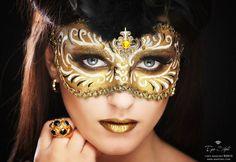 Topaz gems accent an artistic golden masquerade make-up mask.