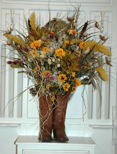 Flowers in cowboy boots. Luv it especially for a western theme party