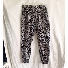 Leopard print harem pants Socialite brand leopard print polyester harem pants with elastic around the waist and ankles. Two pockets. Size medium. Great condition. Last picture is not the same exact pair, just for inspiration. Pants Track Pants & Joggers
