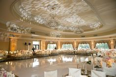 Ballroom Reception at Oheka Castle    Photography: Brett Matthews Photography   Read More:  http://www.insideweddings.com/weddings/regal-outdoor-ceremony-ballroom-reception-at-oheka-castle-in-ny/821/