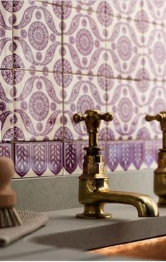 Brass bathroom faucets via Salt and Pepper   Remodelista