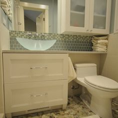 shelf cabinet over toilet and extended counter over toilet. Perfect