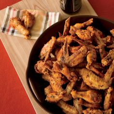 """These crispy chicken wings get their heat from Sriracha, the Thai hot sauce that chef Michael Symon says is his favorite in the world. """"We always hav... Best Chicken Wing Recipe, Chicken Wing Sauces, Crispy Chicken Wings, Sauce For Chicken, Chicken Wing Recipes, Chicken Gravy, Roasted Chicken, Fried Chicken, Salsa Sriracha"""