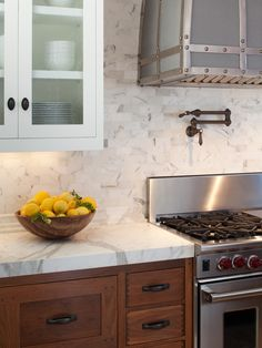 Stunning kitchen with calcutta marble countertops and backsplash.