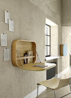 Wishtlist: $2000 - Nubo, by Gamfratesi, is a small decorative wall element that offers a functional working area. When open, it features a cable port for small laptops or tablets and a bar to hold documents.