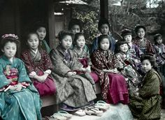Informal group outdoors portrait.  Hand-colored photo, About 1890's, Japan.  Photographer K. Tamamura