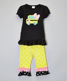 This adorable two piece pants set is perfect for the end of the school year, or a back to school outfit. The top has an appliquéd yellow school bus, complete with adorable ruffle pants.