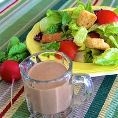 "Creamy Balsamic Vinaigrette | ""This recipe is so quick, easy, and versatile, you may never purchase bottled dressing again. A variety of herbs and spices can be added to suit your personal taste."""