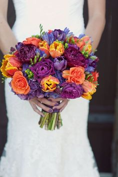 gorgeous puple and coral bridal bouquet! love the bride's matching purple nails too!  ~  we ❤ this! moncheribridals.com