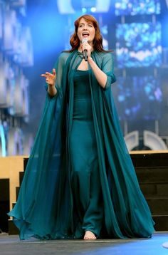 Florence Welch stepped out on stage in a custom Gucci gown with a billowing cape and accented with a glamorous rouge lip at Chime For Change.