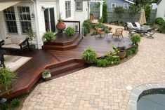 This sort of deck with seating built in on either side of the stairs, and a bigger second tier.