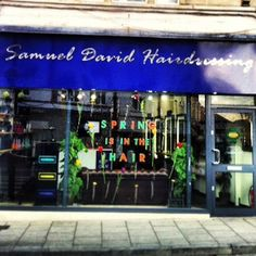Shop front of Samuel David Hairdressing in Westbury-on-Trym, Spring is in the Hair window display march 2013 #hairsalon #bristol #sdhairdressing #ghd #goodsalonguide