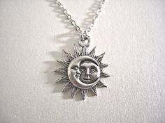 This simple yet eye catchy necklace features antique silver Sun and Moon American cast pewter charm and quality delicate rhodium plated chain. It