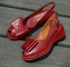 """1940's open toe sling back wedge with bow. - Leather uppers with leather soles - Whole sizes, 5-13 - Medium widths - 2"""" wedge heel with a ½"""" platform - Available in White, Red, Black, and Black/White"""