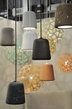 Lamps made of wood, concrete, marble and cork.