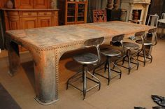 The stools are amazing, the table is intriguing. An Aaron Christensen find! (He's AMAZING!