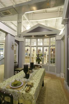 White Columns And Arches Frame A Gray And Taupe Soaking