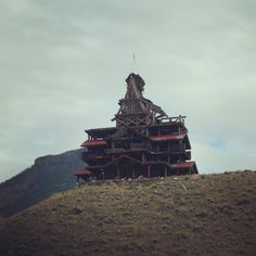 I really wish I knew what this place was. We passed it several times driving between Cody, Wyoming, and the east entrance of Yellowstone National Park. This building was up on a hill, overlooking the highway. It's so strange, yet so cool and unusual. If anyone knows what it is, please tell me!