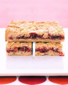Crumbly, buttery almond bars are the perfect treat for snacks or school lunches. Layer in any variety of jam that you like. We used cherry.