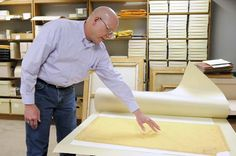 University Archivist Barry Cowan looks at a map of LSU campus Monday, Mar. 2, 2015, in his office in Memorial Hill Library.