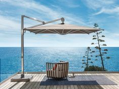 SWING Garden armchair Swing Collection by Ethimo design Patrick Norguet