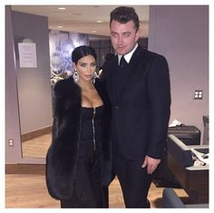 Pin for Later: The Hands-Down Sexiest Things Kim Kardashian Wore in 2015 Kim Chose a Furry Vest, a Cleavage-Baring Top, and Silver Drop Earrings For a Sam Smith Concert Sam Smith looked decidedly modest. If Kim sent out a dress code memo, he probably didn't get it.
