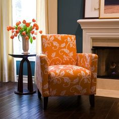 I love this chair and wall color. Would have to completely redo our living room, but how fun!