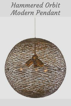 """Varaluz Flow 18"""" Wide Hammered Ore Orb Pendant Light. Flow pendant light is organic and ornate at the same time. Its intriguing shape is made from hand-forged recycled steel and comes in a hammered ore finish. It looks stunning over a reclaimed wood dining table. #modernlighting #lightingfixtures #lighting #modern #rustic. *aff*"""