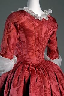 Back, Red damask silk gown, c. 1775, from fabric designed by Anna Maria Garthwaite, 1751. From the collection of the museum of the Fashion Institute of Technology, New York