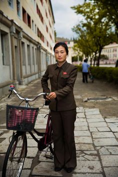 """You will see huge monuments, statues, and communist celebrations, but you almost know nothing about North Korean women."" Mihaela Noroc's portraits from North Korea. http://www.elle.com/culture/news/a31075/portraits-women-north-korea/ via @ElleMagazine"