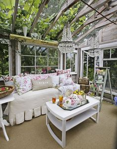 Shabby chic greenhouse  I love this. Now I know what to do with the crystal chandelier that is hanging in our attic. Put it on the porch!