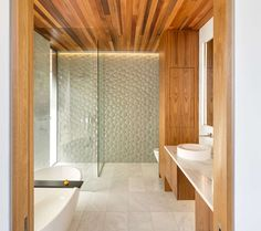 Bathroom Tile Ideas - Install 3D Tiles To Add Texture To Your Bathroom // Bubbly looking glass tiles on the one wall of this bathroom give the room a playful look and add a texture to the space you don't often find in bathrooms.